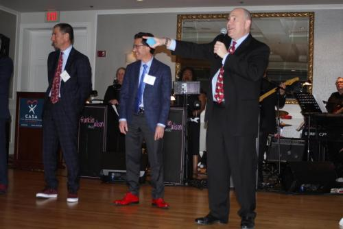 good red shoe contest bidding gala
